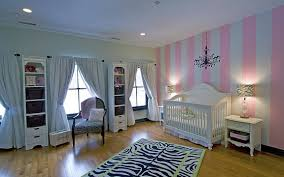 window facing white crib beside end table orange painting wall