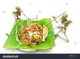 halloween background skeletons ghost skeletons eating pad thai noddle stock photo 322792076