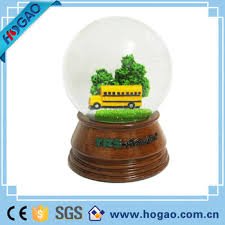 school snow globe with green tree ornament buy