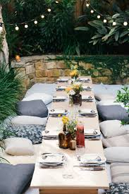 Mesmerizing Lighting Settings The Long Picnic Table Setting With Floor Cushions Rugs And