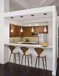 decorating ultra modern kitchen with white bar table and white