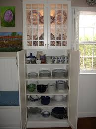 white kitchen pantry storage cabinet made of wood with profile