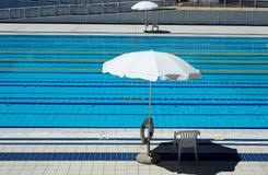 lane swimming races in the olympic swimming pool empty stock photo