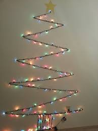 cheap christmas trees with lights i made this christmas tree out of one strand of lights attached to