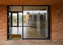 church glass doors hall mcknight u0027s church road house is three brick blocks