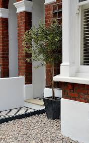plastered rendered front garden wall painted white metal wrought
