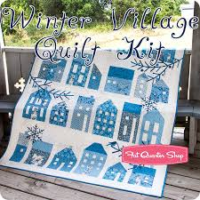 winter village quilt kit featuring blue sky by laundry basket