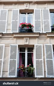 typical french windows balconies blinds paris stock photo 43678576