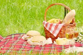 wine picnic basket picnic basket with apples bread cheese wine and sandwiches stock