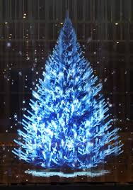 white tree with blue lights alsoastarover white