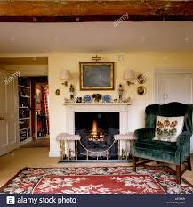 Living Room Rugs Sets Armchair On Rug Set Next To Lit Fire In Sitting Room Of English