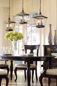 we re proud to present our exclusive metal orb chandelier finely grouped lanterns above a dining room table add a contemporary flair to your traditional home
