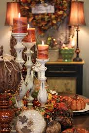 tablescape the white candle holders with the orange candles are so