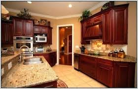 match a paint color to your cabinet and countertop maple kitchen