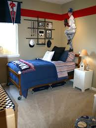 red and creame aviation themed boys room with red steel propeller