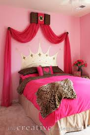 pink and leopard room with princess crown headboard painted on
