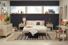 navy blue accent wall bedroom ideas featuring simple white iron