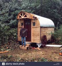 wooden log cabin wooden shepherds hut style log cabin in the woods with a on