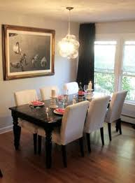 Black Dining Room Chairs Gray Dining Room Features A Tray Ceiling Accented With A Satin