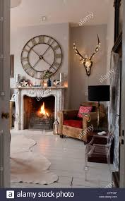 compact wall clock above fireplace 55 wall clock over fireplace