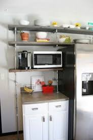 Galvanized Pipe Shelving by Kitchen Shelving Wood And Galvanized Pipe Uniquelyyouinteriors