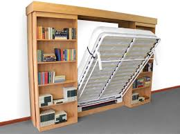 i like this idea the murphy bed hides behind sliding bookshelves