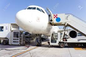 airplane in airport serviced by the ground crew stock photo airplane in airport serviced by the ground crew stock photo 14567278