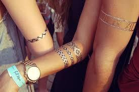 metallic temporary tattoos music festival trends teen vogue