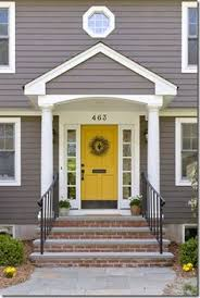 gray exterior white trim and yellow door these are the colors i