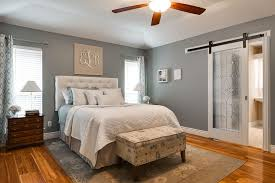 cottage master bedroom with barn door ceiling fan zillow digs