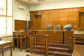 old vintage wooden court room with judge chairs and a witness