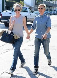 portias hair line ellen degeneres and portia de rossi smooch and hold hands as they