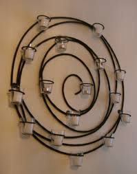 awesome wrought iron wall decor with candles inspirations