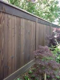 Cheap Backyard Fence Ideas by Building A Horizontal Plank Fence Horizontal Fence Pallets And