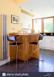 Wall Mounted Breakfast Bar Black And Chrome Stools At Breakfast Bar In Modern Kitchen With