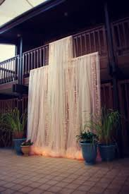 wedding backdrop tulle dramatic tulle and lights wedding ceremony backdrop 11