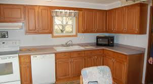 how to reface kitchen cabinets reprinting laminate cabinets she
