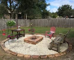 Firepit In Backyard Pit Embers Keep From Killing Grass Wood Covered Patio