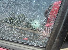 how to fix cracked glass window a rock from a truck just cracked my windshield what should i do