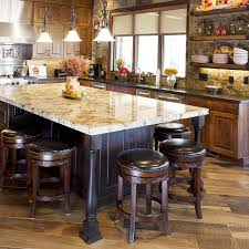 kitchen blonde wooden kitchen island with black granite