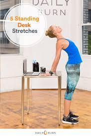 Stand Up Desk Exercises 5 Standing Desk Stretches To Relieve Stress Now Daily Burn