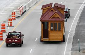 tumbleweed house a tumbleweed brand cypress 24 model tiny house is towed down the