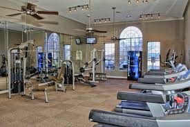 apartment cool apartment gym room idea with brown rubber tiles