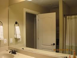 remodelaholic bathroom mirror frame tutorial