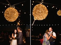 chelsea and nick dance with their parents under the twinkle lights