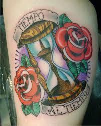 sand clock tattoo designs sand clock and flowers tattoo tattoomagz