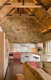 inventive kitchens with stone walls contemporary island white and cabinets combined with captivating rustic backdrop the kitchen