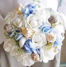 seashell bouquet touch white roses silk blue hydrangeas and lots of