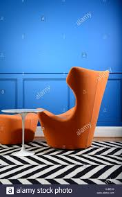 retro chair and ottoman design modern retro orange chair and ottoman by blue wall stock