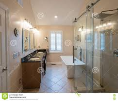 modern bathroom with freestanding tub and vanity stock photo